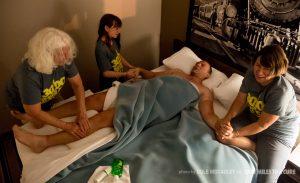 Madisyn Heinstand, Jo Dee Ahmann, and Darla Workman massage Rob before he tries to get a couple hours of sleep.